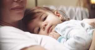 Cinematic and moody shot of baby resting on mom. Shot in 4K RAW on a cinema camera stock footage