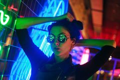 Cinematic night portrait of girl and neon lights royalty free stock photography