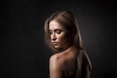 Cinematic portrait of girl in dark studio Royalty Free Stock Photos