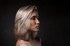 Cinematic portrait of girl in dark studio Royalty Free Stock Image