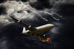 Cinematic Portrayal of Airplane With Engine Fire Stock Photography