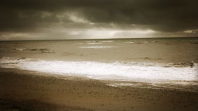 Cinematic Sepia toned overcast beach scene stock video footage