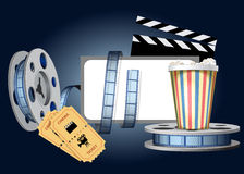 Cinematic set. Cinematographic film, glass with popcorn, tickets and the screen are shown in the image Stock Photos