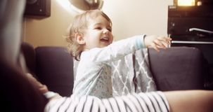 Cinematic shot of happy baby girl pointing at something out of frame. Shot in 4K RAW stock video