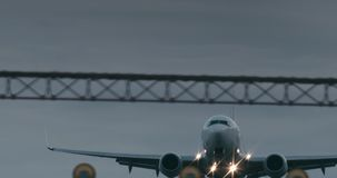 Cinematic shot of a passenger jet airplane about to land. 4K telephoto shot stock video