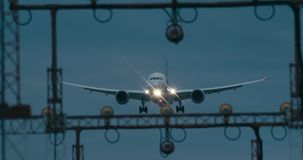 Cinematic shot of a passenger jet airplane about to land. 4K telephoto shot stock video footage