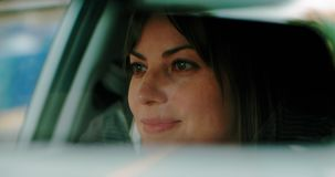 Cinematic shot of a pretty woman driving during the day. 4K Footage stock footage
