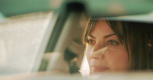 Cinematic shot of a pretty woman driving during the day. 4K Footage stock video footage
