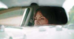 Cinematic shot of a pretty woman driving during the day. 4K Footage stock video