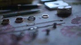 Cinematic shot of wedding rings. Wedding Rings. cinematic shot of wedding rings during ceremnony stock video