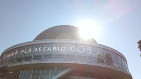 Cinematic sun flare over Galileo Galilei planetarium dome in Buenos Aires