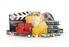Cinematograph in cinema films and popcorn. Isolated on white background Royalty Free Stock Images