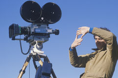 A cinematographer setting up his shot, Stock Photography