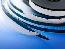 Cinematography. Negative eight millimeter film of the blue background royalty free stock images