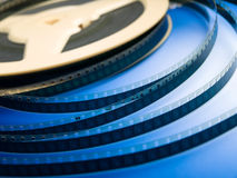 Cinematography. Super 8 film strips on a blue background Stock Image