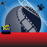 Cinematography. Abstract blue sphere with filmstrip, clapboard and various movie projector shapes. Cinema theme Royalty Free Stock Photo