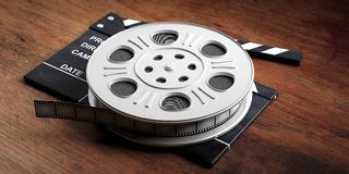 Film movie reel, on a movie clapper and a wooden background, 3d illustration. Cinematography concept. Film movie reel, on a movie clapper and a wooden stock illustration