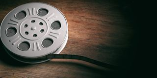 Film movie reel, isolated on a wooden background, copy space, 3d illustration. Cinematography concept. Film movie reel, isolated on a wooden background, copy royalty free illustration