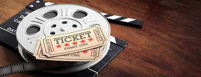 Film reel with retro cinema tickets on top, on a movie clapper, wooden background, copy space, banner, 3d illustration. Cinematography concept. Film reel with stock illustration