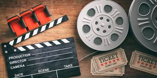 Film reels with retro cinema tickets, movie clapper and red theater seats on wooden background. 3d illustration. Cinematography concept. Film reels with retro vector illustration