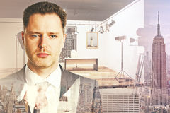 Cinematography concept. Portrait of attractive young businessman on abstract city and studio background. Cinematography concept. Double exposure stock images