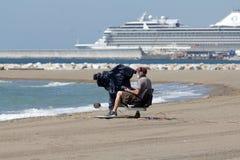 Cineoperatore alla spiaggia Immagine Stock Libera da Diritti