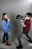 Cineoperatore e cantante immagine stock libera da diritti