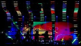 Cineoperatore in un concerto rock Immagine Stock