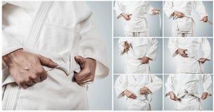 Cinghia di Karateka che lega le immagini graduali Fotografie Stock