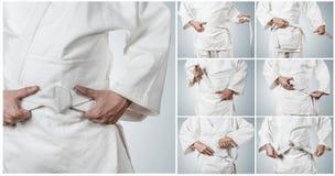 Cinghia di Karateka che lega le immagini graduali Fotografie Stock Libere da Diritti