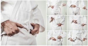 Cinghia di Karateka che lega le immagini graduali Fotografia Stock Libera da Diritti