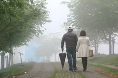 CINGJING FARM, TAIWAN - APRIL 10, 2015. Unidentified couple walking at Cingjing Farm, a famous sheep farm in high mountain at Taiwan on April 10, 2015. Mostly Royalty Free Stock Photography
