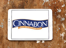 Cinnabon bakery restaurant logo. Logo of Cinnabon bakery restaurant on samsung tablet on wooden background Royalty Free Stock Photo