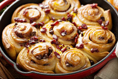 Cinnabon buns with cranberry and orange glaze Royalty Free Stock Photos