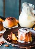 Cinnabon cinnamon buns with cream and cheese sauce Royalty Free Stock Photos
