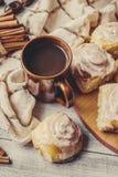 Cinnabon cinnamon and cream for tea. Selective focus Stock Image