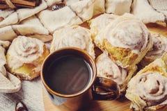 Cinnabon cinnamon and cream for tea. Selective focus Royalty Free Stock Photography