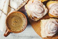 Cinnabon cinnamon and cream for tea. Selective focus Stock Photos