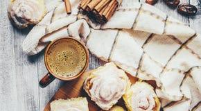 Cinnabon cinnamon and cream for tea. Selective focus Royalty Free Stock Photos