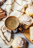 Cinnabon cinnamon and cream for tea. Selective focus Royalty Free Stock Images