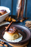 Cinnabon cinnamon rolls, almonds and mandarins on a dark plate Stock Image