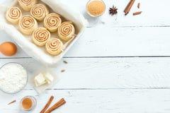 Cinnabon rolls. Cinnamon rolls or cinnabon, homemade recipe raw dough preparation sweet traditional dessert buns pastry food. Food ingridients for cinnamon rolls royalty free stock photos