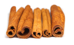 Cinnamon. Pieces of cinnamon bark isolated on white Royalty Free Stock Photos
