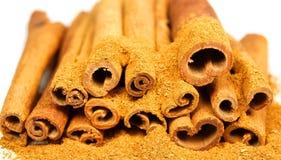 Cinnamon. Macro photo of cinnamon powder with bark Royalty Free Stock Photos