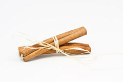 Cinnamon. A lot of cinnamon with white background Stock Images