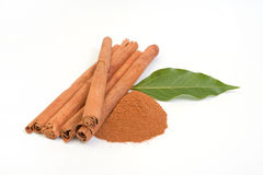 Cinnamon. Sticks and powder of cinnamon on white background