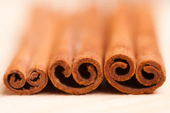 Cinnamon. Three Cinnamon sticks on white background Royalty Free Stock Images