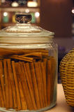 Cinnamon. Sticks in glass jar royalty free stock photos