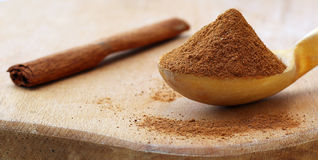 Cinnamon. Sticks and powder in spoon on wooden table Royalty Free Stock Photos