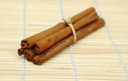 Cinnamon. Sticks on bamboo mat Stock Image